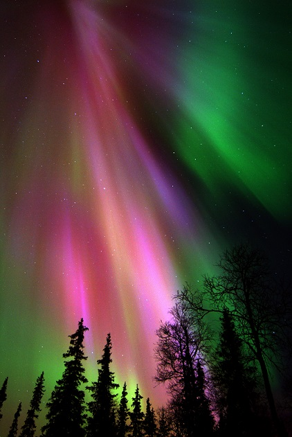 Red and green aurora over Finland